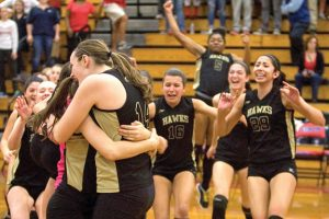Woodland volleyball players celebrate after beating Foran High, 3-1, to win the Class M championship on Nov. 16, 2013. –RA ARCHIVE