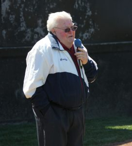 Wendle Stiber, of Naugatuck, speaks during Peter J. Foley Little League's opening day ceremony in April. Stiber, the director of Connecticut District III Little League, has dedicated his time to Little League for over 50 years. –FILE PHOTO