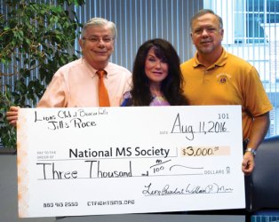 Beacon Falls Lions Club member Jack Betkoski, left, and Lions Club President William Mis, right, present a $3,000 check to Lisa Gerrol, president of the National Multiple Sclerosis Society, Connecticut Chapter. The funds were raised from the first Jill's Race For MS, which was sponsored by the club, held in August. The race was named in honor of Betkoski's sister and former Beacon Falls resident Jill Betkoski, who lost her battle with multiple sclerosis 10 years ago. –CONTRIBUTED