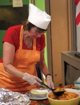 Volunteer and St. Michael's Church parishioner Diane Caggiano makes homemade peach shortcake last year during the church's 57th Annual Village Green Fair on the Naugatuck Green. The annual fair is known for the shortcake. –FILE PHOTO