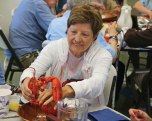 Pauline Cacace, of Cheshire, prepares to eat a lobster during the Prospect Senior Center's Lobster Dinner Aug. 30. –LUKE MARSHALL