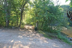 A trail is being cleared as part of ongoing improvements at Riverbend Park in Beacon Falls. The improvements will also include a water break in the Naugatuck River, plantings, signage and benches. –LUKE MARSHALL