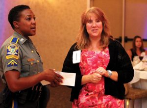 United Way of Naugatuck and Beacon Falls Executive Director Lisa Shappy, right, talks with Trooper First Class Kelly Grant, the public information officer for the Connecticut State Police, during the United Way's 2016 Campaign Kickoff Sept. 15 at The Crystal Room in Naugatuck. Grant was the guest speaker for the event. –ELIO GUGLIOTTI