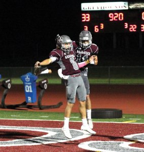 Naugatuck's Michael Plasky (8) and Jalen Datil (11) celebrate after the two connected on a touchdown versus Torrington Sept. 23 in Naugatuck. Naugatuck won the game, 52-0. –ELIO GUGLIOTTI