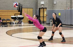 Woodland's Rachel Poulos hits the ball off a serve as Julia Swiatek (6) backs her up Sept. 21 versus Wilby in Beacon Falls. Woodland won, 3-0. –ELIO GUGLIOTTI