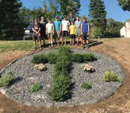 Boy Scout Jeffrey Varesio, of Troop 258 in Prospect, worked on his Eagle Scout project Sept. 17 at Saint Vincent Ferrer Church in Naugatuck. He landscaped an area of the grounds, creating a cross shrubbery with crushed rock. His fellow Boy Scouts from Troop 258, friends, and family assisted him with his project. Pictured, Adam Telesca, Jacob Marks, Kyle Bolduc, Matthew Hankey, Jeffrey Varesio, Brandon Peach and Zach Cochran. Not pictured, Nathan Bouffard, Casey Redd, Brian Kieffer and Gabriel Johnson. –CONTRIBUTED