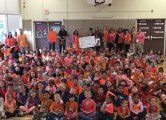Students and teachers at Western Elementary School in Naugatuck wear orange to raise awareness of child hunger during the Western School Goes Orange program Oct. 4. Students collected food to donate to the Naugatuck Ecumenical Food Bank as part of the program. –CONTRIBUTED