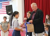 St. Francis-St. Hedwig School seventh-grader Ashley Galvao, left, receives a medal from Naugatuck Mayor N. Warren 'Pete' Hess for being the highest performing reader in her grade Sept. 23 during an event to kick off the school's annual reading program at the school in Naugatuck. This year's program, called Ready Set Read, has an Olympic theme and was kicked off with an Olympic-style opening ceremony. –LUKE MARSHALL
