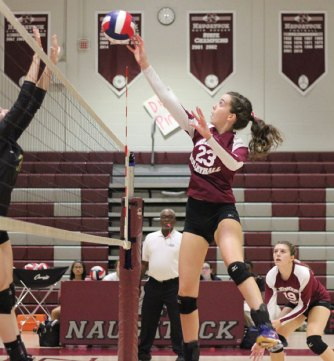 Naugatuck's Taylor Hyde leaps to hit the ball over the net Tuesday night versus Woodland in Naugatuck. Woodland won the match, 3-1. –ELIO GUGLIOTTI