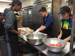 Students from Naugatuck High School's DECA chapter helped out at the St. Vincent DePaul Mission soup kitchen in Waterbury on Oct. 30. Students spent the day providing meals and served over 150 people. –CONTRIBUTED