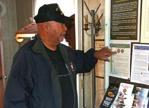 U.S. Air Force veteran Frank Edmonds points to an example of the Vietnam War Commemoration pin that American Legion Post 17 presented to 30 Vietnam era veterans recently. –LUKE MARSHALL