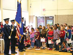 Western Elementary School third-graders sing the national anthem as members of the Naugatuck High School Air Force JROTC present the American flag and the Connecticut state flag during Western's annual Veterans Day Celebration Nov. 7 at the school in Naugatuck. The event, which was attended by more than 20 veterans, featured patriotic music and a speech by retired U.S. Air Force Lt. Col. Valerie Lofland of the JROTC program. –LUKE MARSHALL