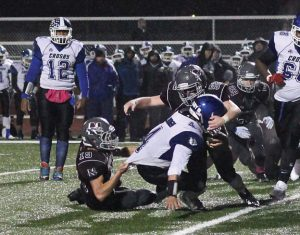 Naugatuck's defense, including Hubert Lutrzykowski (19) and Michael Natkiel (52), shut out three opponents this season and will have to shut down a potent Ansonia offense that has scored 49.4 points per game this year. –ELIO GUGLIOTTI