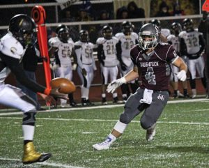 Naugatuck's Brandon Papp (4) broke his leg on the second play of his freshman season. Papp, a senior, fully recovered to become an impact player on a resurgent Naugatuck defense that shut out three straight opponents this season. –ELIO GUGLIOTTI