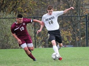 Woodland's Senol Music (18) fends off Torrington's Nick DalleValle (10) Saturday during a quarterfinal match of the NVL tournament in Beacon Falls. Woodland beat Torrington before falling Tuesday to Oxford in the semifinals. –ELIO GUGLIOTTI