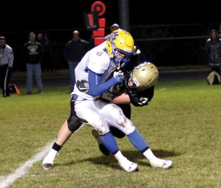 Woodland's Jackson Henry (74) tackles Seymour's Bobby Melms (6) in the backfield Nov. 23 in Beacon Falls. Seymour won the game, 55-20. –ELIO GUGLIOTTI