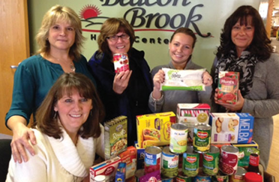 Beacon Brook Health Center in Naugatuck recently held a non-perishable food drive to benefit the Naugatuck Ecumenical Food Bank. Staff, families and residents participated in collecting food. Pictured, from left, employees Karen Wilke, Nicole Pagliaro, Kathy Stabile, Crystal Oestreich and Debbie Vogen. –CONTRIBUTED