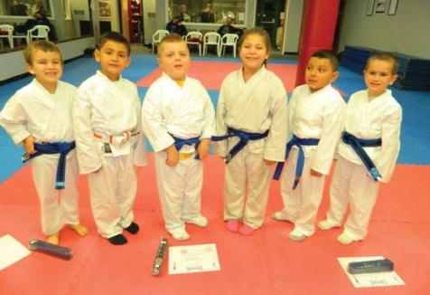 Brandon Gagnon, Michael Salgado, Dallas Autore, Victoria Hernandez, Roberto Arriga and Charlie Clark advanced in rank during a karate grading Nov. 14 at USA Martial Arts in Naugatuck. –CONTRIBUTED