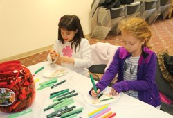 Mya Fontes, 7, right, and Ella Iannone, 7, both of Prospect, create as Christmas tree-shaped ornament on Dec. 15 at the Prospect Library. –LUKE MARSHALL