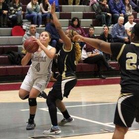Naugatuck's Michelle Cordova (4) drives to the basket past Waterbury Career's Shyra Fisher (4) Dec. 27 in Naugatuck. –ELIO GUGLIOTTI