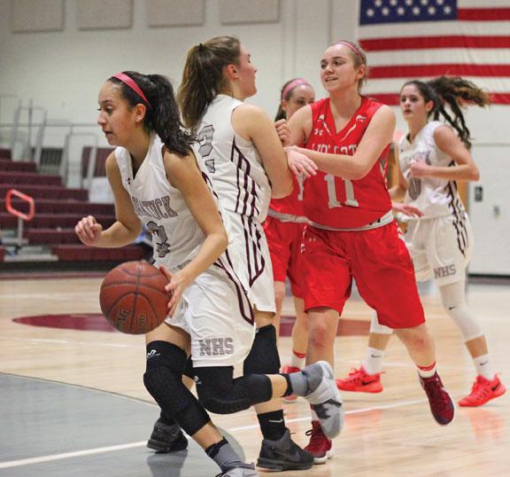 Naugatuck's Alyana Sosa (3) drives to the basket as Hailey Deitelbaum (12) sets a pick on Wolcott's Raven Cody (11) Tuesday at Naugatuck High School. Wolcott won the game, 35-26. –ELIO GUGLIOTTI