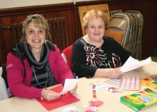 Naugatuck residents, Jennifer Lawson, left, and her mother, Linda Lawson, work on valentines during the Trumbull-Porter Chapter Daughters of the American Revolution's tenth annual Valentines for Veterans Workshop at Grace Lutheran Church in Naugatuck Jan. 21. In total, 162 valentines and 195 individual bags of assorted candies were made for veterans at the Newington, Rocky Hill and West Haven veterans hospitals. –CONTRIBUTED