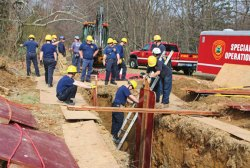 Firefighters from the Naugatuck and Waterbury fire departments practice trench rescue techniques with help of members of the Connecticut Fire Academy April 17 at Baummer's Pond in Naugatuck. The training, which is done annually, teaches firefighters how to safely rescue people who have been trapped in situations such as a foundation collapsing during construction work or when a trench collapses during road work. Members of the Naugatuck Fire Department said these types of rescues aren't common but do occur. –LUKE MARSHALL