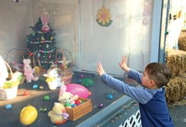 Devin Caulfield, 4, of Naugatuck, takes a closer look at some Easter decorations during the Naugatuck Parks and Recreation Department's annual Easter Village April 14. –LUKE MARSHALL
