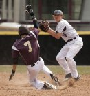 Naugatuck's Derrick Jagello (10) turns the double play after getting Sacred Heart's James Edwards (7) out at second base April 3 at Naugatuck High School. -JIM SHANNON/REPUBLICAN-AMERICAN