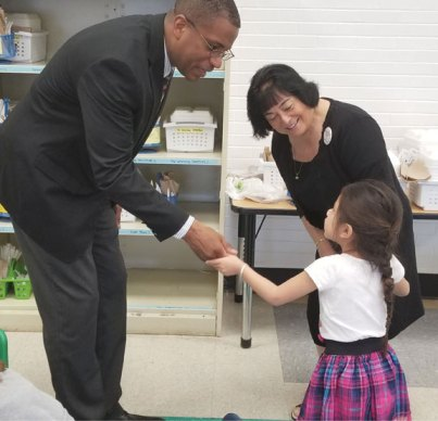 State Sen. George Logan, R-17th District, left, is greeted by a student during a tour of the Early Childhood Center at Central Avenue School in Naugatuck on April 28. Logan, who serves on the state legislature's Education Committee, was guided on the tour by the center's Director Jackie Bacon, center. –CONTRIBUTED