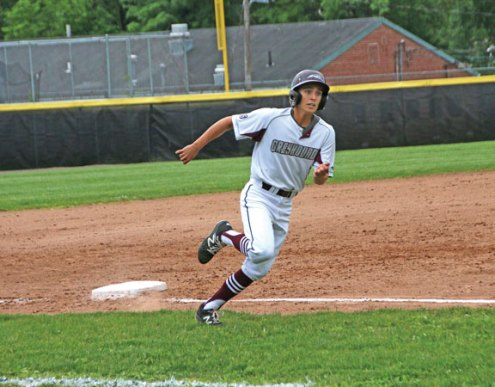 Naugatuck's Mike Patton rounds third and heads home after a double by Corey Plasky against Trumbull during the first round of Class LL tournament Tuesday at Naugatuck High School. Naugatuck won the game, 4-0. –LUKE MARSHALL