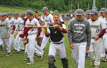Naugatuck's Michael Natkiel (15) waves a flag on his way back to the dugout after celebrating the end of an inning with the team against Trumbull during the first round of Class LL tournament Tuesday at Naugatuck High School. Naugatuck won the game, 4-0. –LUKE MARSHALL