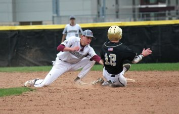 Naugatuck's Corey Plasky tags out Woodland's Zack Bedryczuk (12) as he attempts to steal second base Sunday at Naugatuck High School. Woodland won the game, 7-3. –ELIO GUGLIOTTI