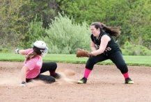 Woodland's Elizabeth Triana (18) goes in to tag out Naugatuck's Hailey Deitelbaum at second base May 10 at Woodland Regional High School in Beacon Falls. –ELIO GUGLIOTTI