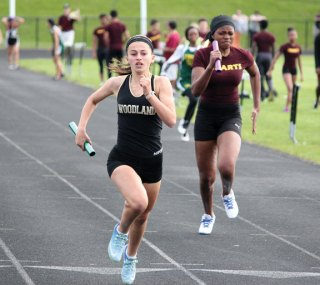 Woodland's Julia Accetura sprints to the finish in the 4x100 Tuesday during a meet against Sacred Heart, Kennedy, O'Brien Tech and Platt Tech in Beacon Falls. –ELIO GUGLIOTTI
