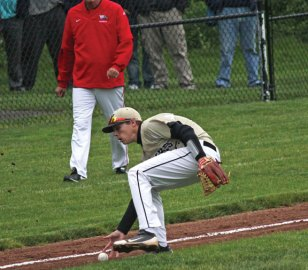 Woodland's Mike Szturma fields a bunt on the third base line Tuesday versus Wolcott in the first round of the Class M tournament in Beacon Falls. Wolcott won the game, 13-6. –ELIO GUGLIOTTI