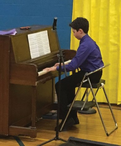 Cross Street Intermediate School in Naugatuck held a student talent show in May. Pictured, Dylan Trochsler plays 'Boogie-Woogie' by Jimmy Dorsey on the piano. –CONTRIBUTED