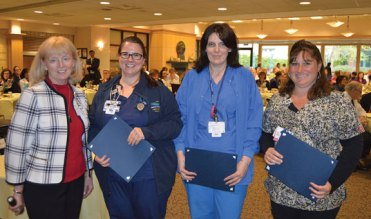 From left, Griffin Hospital Vice President of Patient Care Barbara Stumpo presents Diana Konecny of Beacon Falls, Karyn Spaulding of Seymour and Tracy Volpe of Cheshire with 2017 Nightingale Award for Excellence in Nursing during the hospital's 31st annual Nurse Day Celebration in Derby. Tania Cote of Naugatuck also received the award. –CONTRIBUTED