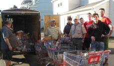 Naugatuck Boy Scout Troop 109 collected over 100 bags of food and $650 during its annual food drive for the Naugatuck Ecumenical Food Bank. The scouts are pictured delivering the donations to the food bank on Spring Street in June. –CONTRIBUTED