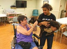 Kat Newsome of Prospect holds a baby goat for Christine Sakocius to pet on June 12 at Beacon Brook Health Center in Naugatuck. Newsome and four other teens were at the health center as part of a program run by Kelly's Kids, a nonprofit organization in Prospect. Kelly's Kids recently received a grant from the United Way of Naugatuck and Beacon Falls to host a five-week intergenerational program at the health center. Kelly's Kids Executive Director Kelly Cronin said the program lets teenagers and older people bond over animals. –LUKE MARSHALL