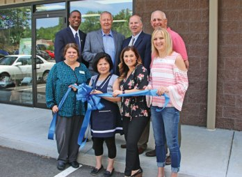Officials celebrated the grand opening of Leilani Nail Spa at 1177 New Haven Road in Naugatuck on June 15. Pictured, front row from left, Ion Bank manager Marianne Como, spa owner Hwacha Yie, Naugatuck Chamber of Commerce Director Courtney Ligi, Burgess Lori Jackson; back row from left, state Sen. George Logan, Mayor N. Warren 'Pete' Hess, state Rep. David Labriola and Naugatuck Economic Development Corporation President and CEO Ron Pugliese. –LUKE MARSHALL