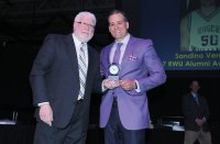 Project Purple founder and CEO Dino Verrelli, right, receives the Athletics Alumni Award from Roger Williams University, his alma mater, from RWU Director of Athletics David Kemmy at the university's 2017 athletics award banquet. The award is presented annually to alum who have shown outstanding commitment to RWU athletics and outstanding community service efforts post-graduation. Project Purple is a nonprofit organization with a mission of raising awareness and funds toward a cure of pancreatic cancer. 'His support and dedication to his cause and the Purple Project mission is something to be admired and continues to be a lifeline to many families that are affected by this awful disease,' said Kemmy in a press release. -CONTRIBUTED