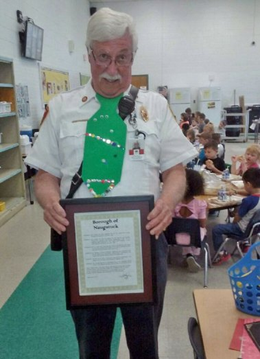 The Early Childhood Center at Central Avenue in Naugatuck recently honored Naugatuck Deputy Fire Marshal William Scanlon for his efforts over the last 13 years for the preschool children and families at the center, including organizing events at the firehouse. Scanlon, who plans to retire in August, also received a proclamation from Mayor N. Warren 'Pete' Hess for his fire safety contributions to Naugatuck's students. –CONTRIBUTED