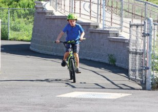 Jace Butkevich, 9, of Oakville, rides his bicycle around the track at Naugatuck High School during a mini-triathlon Auf. 1. The triathlon was part of a six-week Race4Chase Kid's Triathlon program hosted by the Naugatuck YMCA. The program, which was founded to celebrate the life of Chase Kowalski who was one of the students killed during the shooting at Sandy Hook Elementary School in 2012, concluded with a triathlon at YMCA Camp Sloper in Southington on Aug. 5. –LUKE MARSHALL