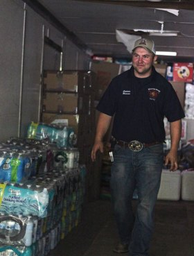 Beacon Hose Company No. 1 Capt. Cal Brennan works to fill the company's 40-foot trailer with donations at the firehouse in Beacon Falls on Aug. 30. Beacon Hose collected donations to aid Hurricane Harvey relief efforts and a group of firefighters volunteered to drive them to Texas. –ELIO GUGLIOTTI