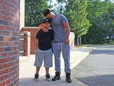 Santos Vargas gives his son, Julius Vargas, 9, a kiss before the start of the first day of school in Naugatuck on Aug. 28. Julius is starting fourth grade at Hop Brook Elementary School.