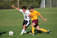 Woodland's Christian Poirier (10) and Sacred Heart's Leandro Fernandes (15) battle for the ball Oct. 13 at Woodland Regional High School in Beacon Falls. Woodland won the game, 4-1. –ELIO GUGLIOTTI