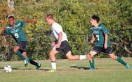 Woodland's Maciej Lewicki (5) pushes the ball past Wilby's Shawn Henry (9) and Marc Calle (7) Sept. 29 at Woodland Regional High School in Beacon Falls. Woodland won the game, 5-0. –ELIO GUGLIOTTI