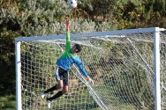 Woodland's Ryan Lamb leaps to ensure the ball goes over the crossbar against Wilby Sept. 29 at Woodland Regional High School in Beacon Falls. Woodland won the game, 5-0. –ELIO GUGLIOTTI