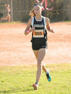 Woodland's Emilie Noreika runs during the Naugatuck Valley League cross country championship meet Oct. 18 at Veterans Park in Watertown. Noreika finished 18th overall. The Woodland girls placed third. –ELIO GUGLIOTTI